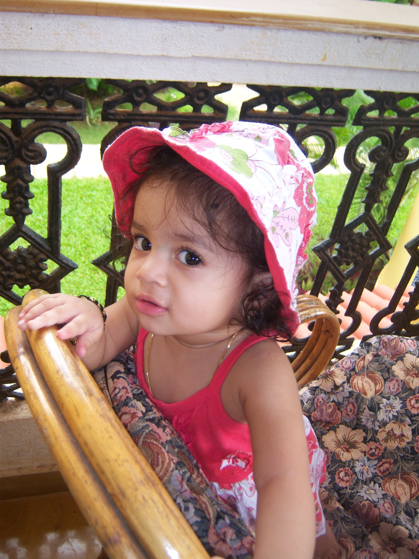 flower girl.JPG - I hope my new hat's in the frame...  in the balcony of our suite at Casa de Goa! Dressed for the ocassion!