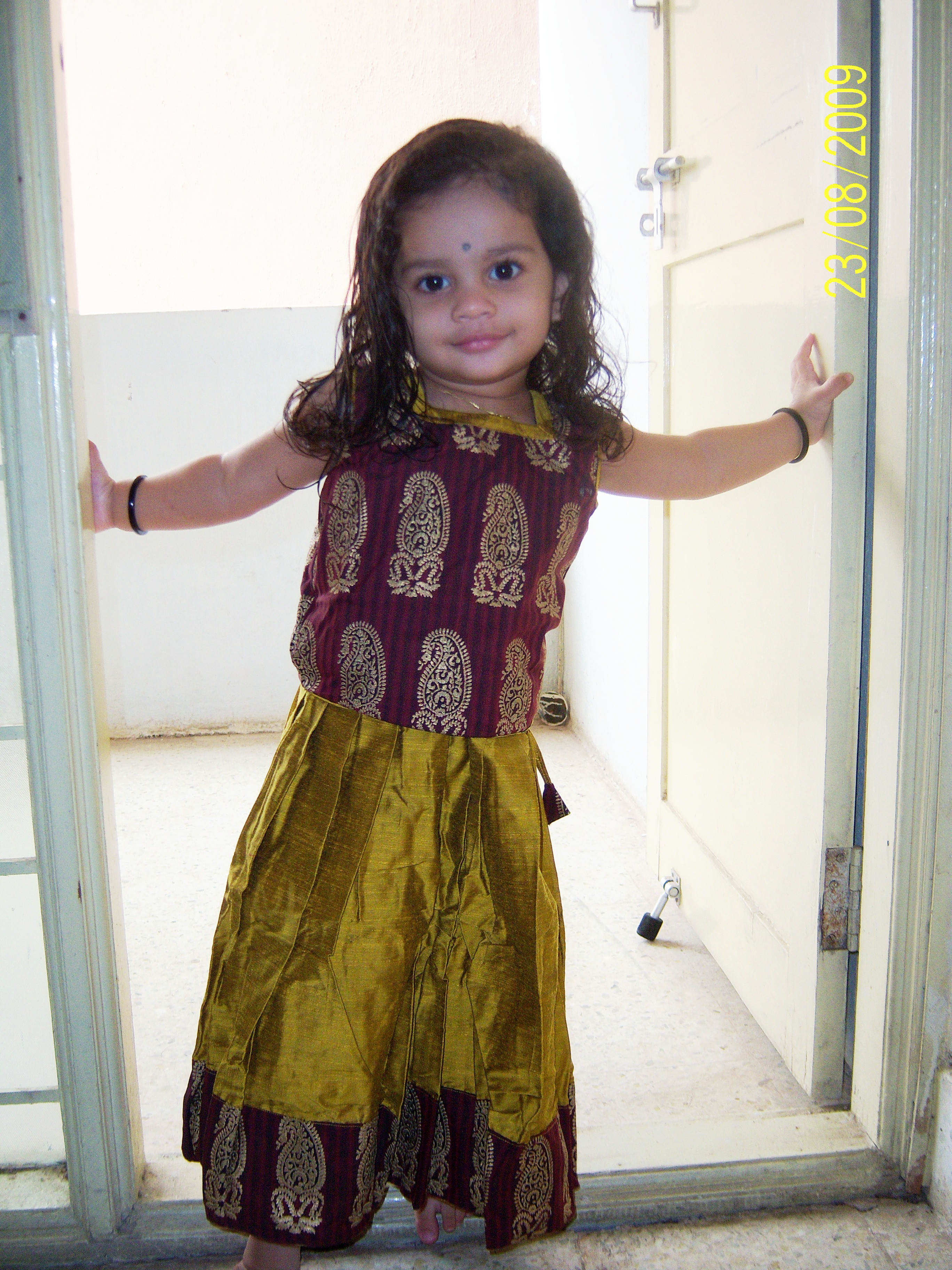100_0898.JPG - Don't I look like a traditional Indian baby should on Diwali?